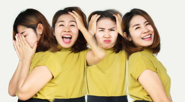 Asian Woman Having Mood Swings With Different Emotions Happy, An